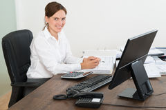 Accountant Doing Calculation At Desk Royalty Free Stock Photography