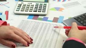 Accountant examines the annual report stock footage