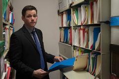 Accountant in File Storage Room Royalty Free Stock Image