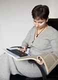 Accountant finds a calculator. Woman accountant working with the data Stock Photo