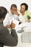 Accountant Giving Couple Bad News Royalty Free Stock Photos