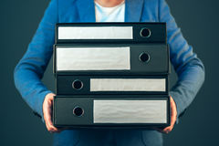 Accountant holding document binders with copy space. Accountant holding document binders with archived paperwork and other corporate legal sheets, mock up copy royalty free stock image