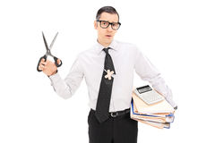 Accountant holding scissors and pile of documents Royalty Free Stock Photo