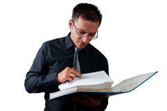 Accountant looking for a document  on white. Accountant looking for a document in to his folder  on white background Stock Photo