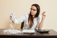 Accountant looks at remains of financial document Stock Images
