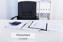 Accountant name plate on desk Stock Photos