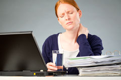Accountant with Neck Pain. A businesswoman experiencing physical discomfort - a pain in her neck due to stress or too much work Stock Photography