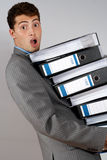Accountant with pile of docume Stock Photos
