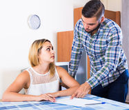 Accountant pointing girl at money issues during meeting Stock Image
