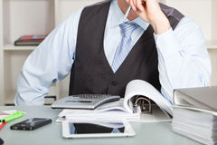 Accountant Problems. Accountant stares at his calculator wishing for a solution Royalty Free Stock Photography