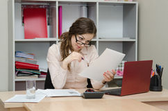 Accountant reading an important document Stock Photography