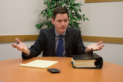Accountant in Suit Gesturing in Meeting Royalty Free Stock Photography
