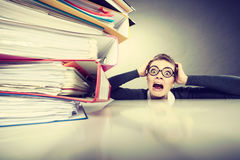 Accountant terrified of pils of binders. Stock Photos