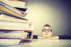 Accountant terrified of pils of binders. stock images