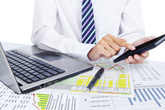 Accountant using a calculator. Successful accountant working with financial data Stock Image