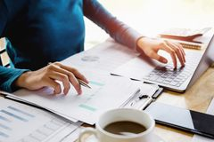 accountant woman working on desk business finance stock photo