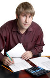 Accountant at work. Male accountant working with papers and calculator Royalty Free Stock Photography