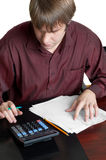 Accountant at work. Male accountant working with papers and calculator Stock Photo