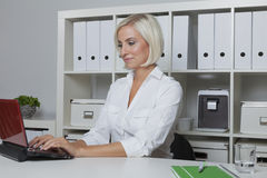 Accountant working with laptop in her office Stock Photography