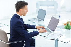 Accountant works with financial documents at workplace in office Stock Photo