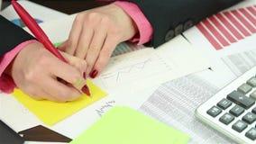 Accountant Writing Amount Of Earnings stock footage
