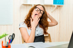 Accountant yawning at his desk after a  work Royalty Free Stock Photography