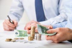 Accountants calculating profit Stock Photos