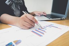 Accountants are examining the company`s finances to prepare business. Development plans for East Asia royalty free stock photography