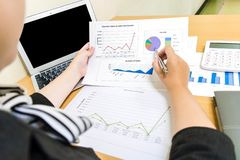 Accountants are examining the company`s finances to prepare business stock photos