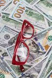 Accountants red glasses on dollar money background Stock Photo