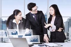 Accountants talking financial chart in office Stock Photos