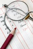 Accounting. Rimmed glasses and accounting calculus Royalty Free Stock Photography