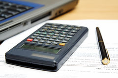 Accounting. A laptop, calculator and accounting paperwork showing typical business environment setting