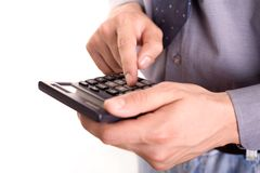 Accounting. Businessman holding calculator, focus on the finger on number 5 royalty free stock photography