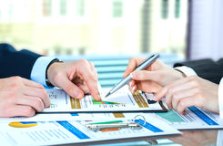 Accounting. Image of male hand pointing at business document during discussion at meeting Stock Photo