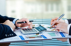 Accounting. Image of male hand pointing at business document during discussion at meeting Stock Images