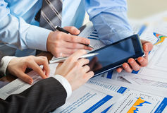 Accounting. Image of male hand pointing at business document during discussion at meeting Stock Photography