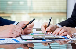 Accounting. Image of male hand pointing at business document during discussion at meeting Royalty Free Stock Photography