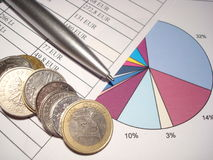 Accounting. Paper sheets with statistics, pen and money stock photography