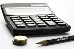 Accounting. Calculator, pencil and small change on white Royalty Free Stock Image