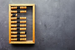 Accounting abacus on gray textured background