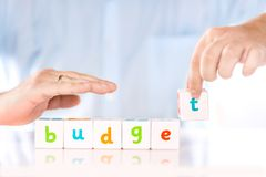 Accounting banking finance or business concept. Male hands collect word Budget from cubes stock photos