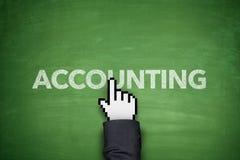 Accounting on blackboard. Accounting word on green blackboard with hand Stock Photo