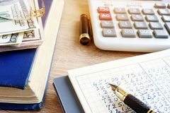 Accounting book and calculator. Home finances. Accounting book, currency and calculator. Home finances stock image
