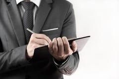 Accounting.Business-Aufzeichnungen in den Händen der Männer Stockfotografie