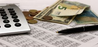 Accounting, business calculations, calculator, counting of funds stock photo