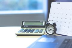Accounting business concept. Calculator with calendar and clock royalty free stock images