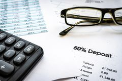 Accounting business concept. Calculator with accounting report and financial statement stock photo