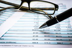 Accounting business concept. Glasses with accounting report and financial statement on desk royalty free stock images