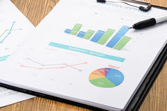 Accounting business and financial report with pen on wood table Stock Photography